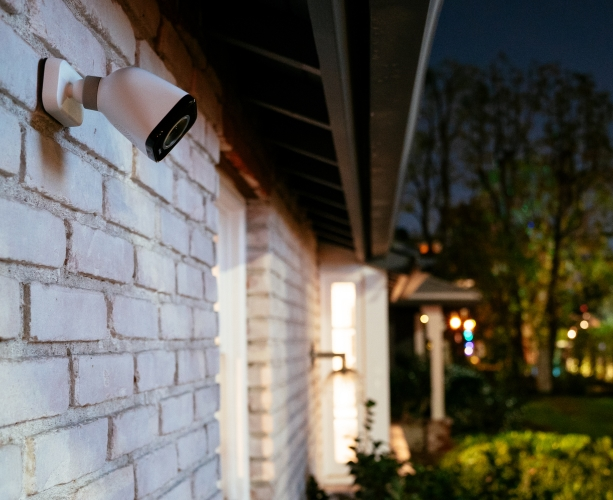 Vivint outdoor camera pro on house wall