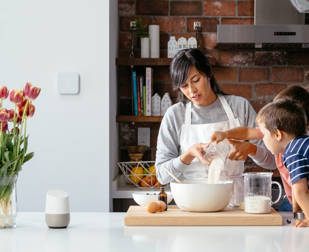 mum bakes with kids with vivint thermostat and google home in kitchen