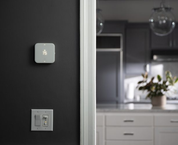 Vivint element thermostat on a wall
