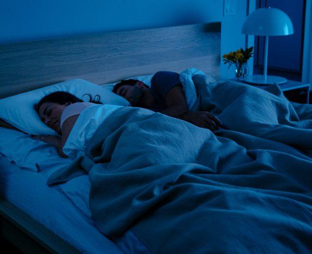 Couple asleep with google home mini