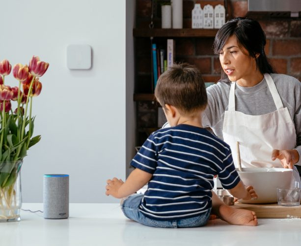 Mum in kitchen with vivint smart home products