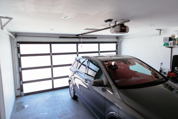car in garage with garage door opener