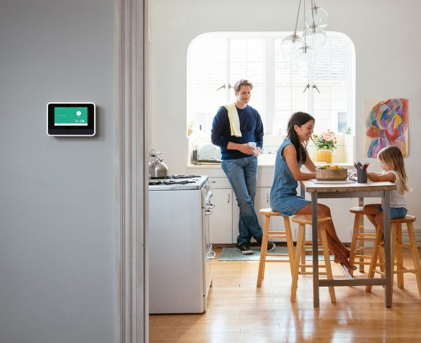 family at home with Vivint smart hub