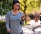 Woman checks phone for vivint water sensor