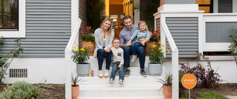 Happy family recommending Vivint